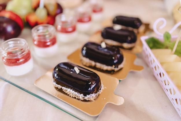 Sweet festive buffet, fruit, caps, macaroni and lots of sweets Premium Photo