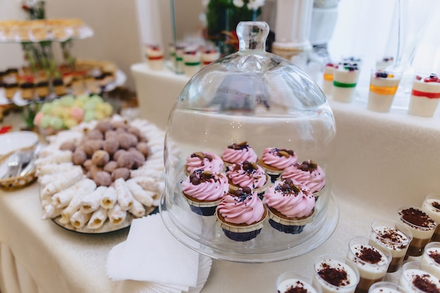 Sweet festive buffet, fruit, caps, macaroni and sweets Premium Photo