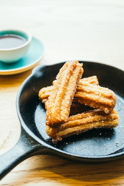 Sweet fried churros donut with chocolate sauce Free Photo
