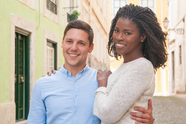 Sweet happy mix raced couple posing together Free Photo