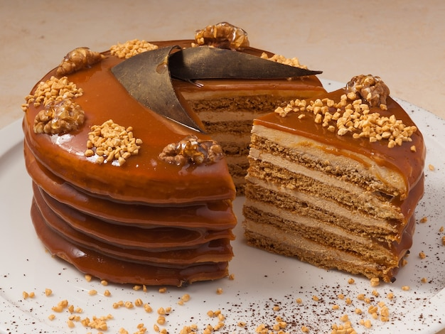 Premium Photo Sweet Honey Cake Decorated With Walnuts And Caramel