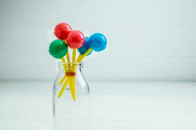 The sweet lollipops of the children on the table Premium Photo