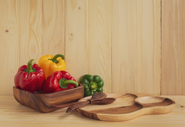 Sweet peppers on wooden table background Premium Photo