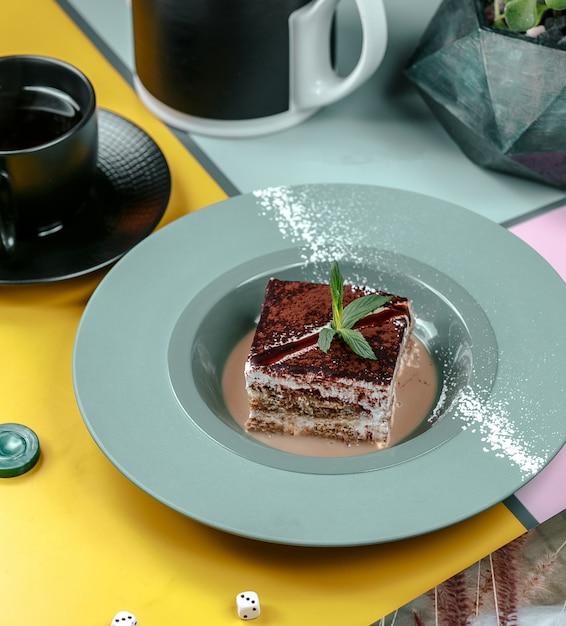 Sweet piece of tiramisu in the plate Free Photo