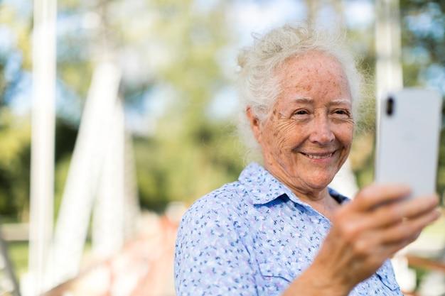 Sweet senior woman taking a selfie Premium Photo