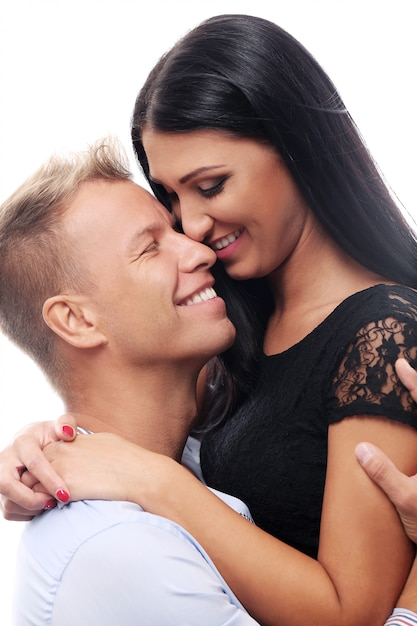Sweet and sexy couple having a photo session in studio Free Photo