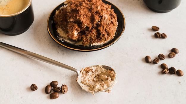 Sweet tiramisu on white table Free Photo