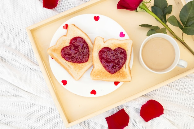 Sweet toasts with coffee on tray Free Photo