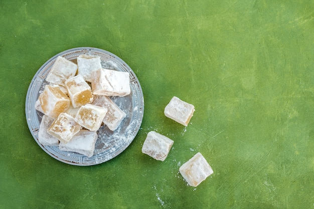 Sweet turkish delight on plate on table Free Photo