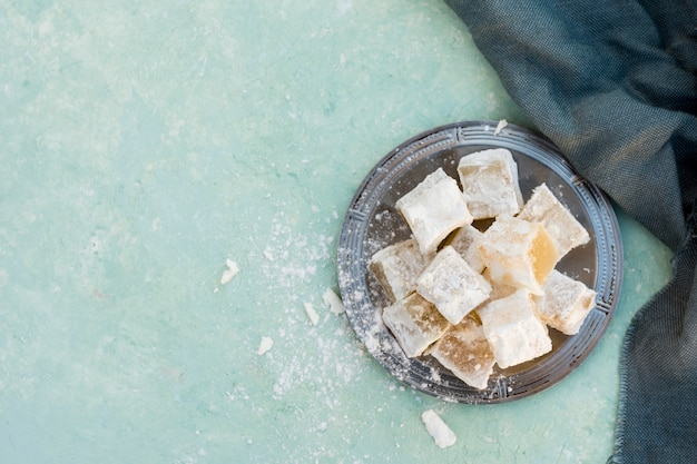 Sweet turkish delight with cloth on table Free Photo