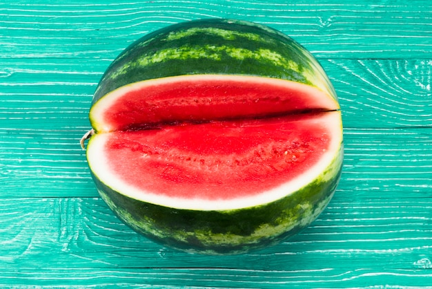 Sweet watermelon with cutout on green background Free Photo