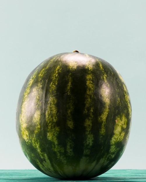 Sweet whole watermelon on blue background   Free Photo