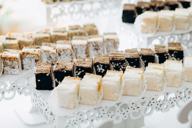 Sweets are served on layered stands Free Photo