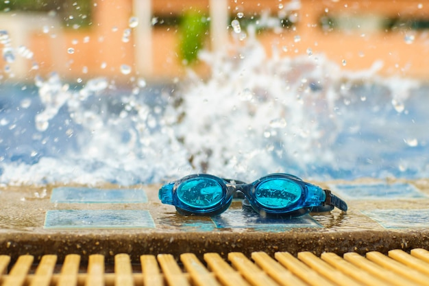 Swimming glasses at the pool with water distribution. Premium Photo
