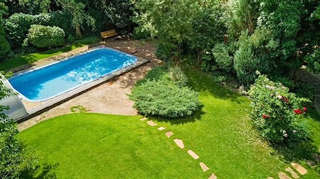 Swimming pool in beautiful garden aerial top view Premium Photo