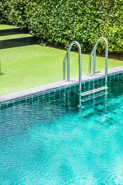 Swimming Pool Background swimming pool ladder with grass background photo | free download
