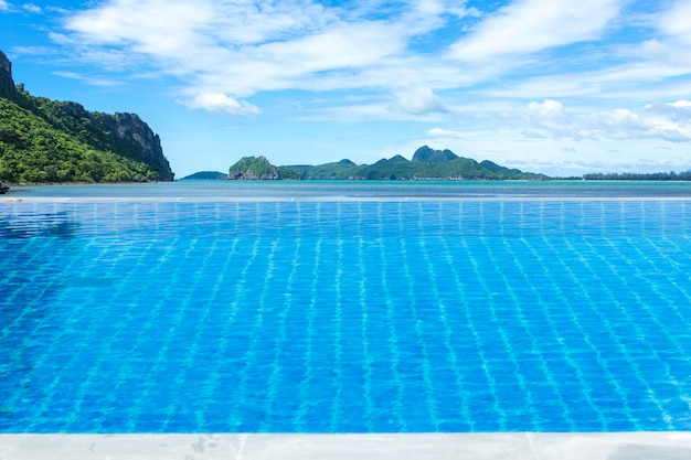 Swimming pool sea view mountain and clouds Premium Photo