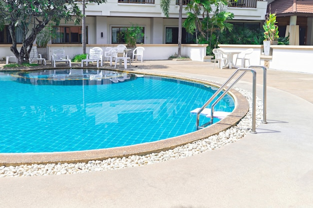 Swimming pool with grab bars ladder Premium Photo
