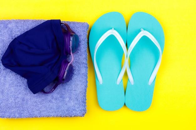 Swimming set - slippers, towel, goggles, swimming cap Premium Photo