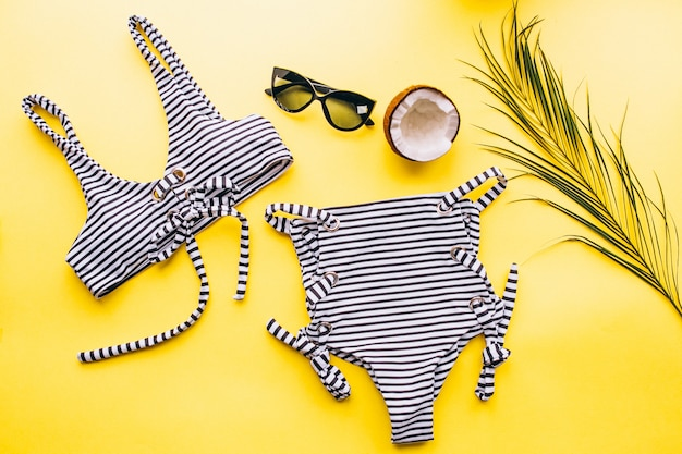 Swimsuit on yellow background isolated Free Photo