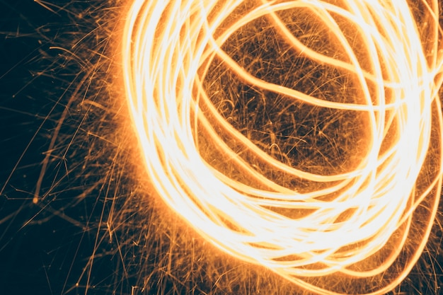 Swirling fire effect on black background Free Photo