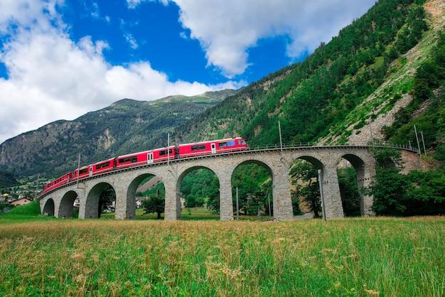 Swiss mountain train bernina express cross the bridge in the cir Premium Photo