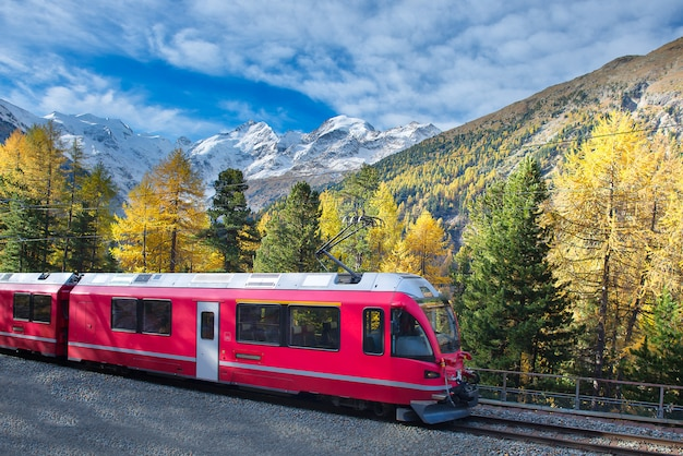 Swiss mountain train bernina express crossed alps in autumn Premium Photo