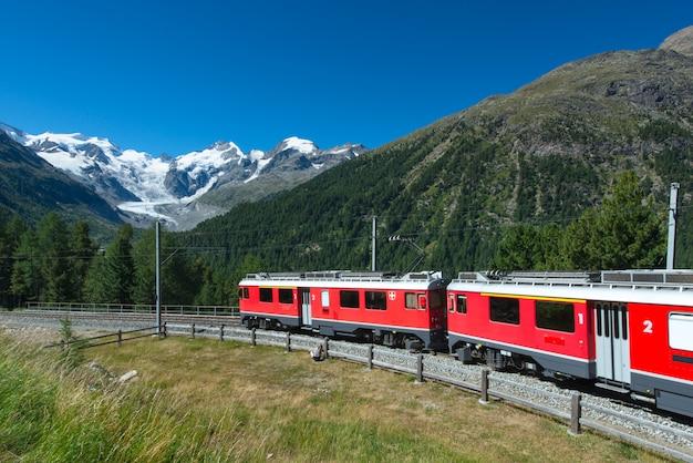 Swiss mountain train bernina express crossed alps Premium Photo