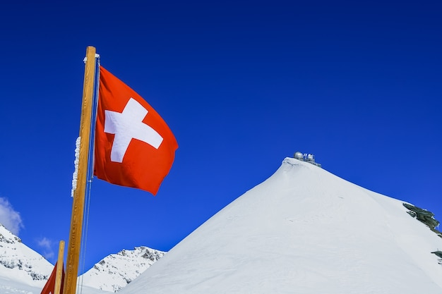 Switzerland flag and sphinx observatory at top of