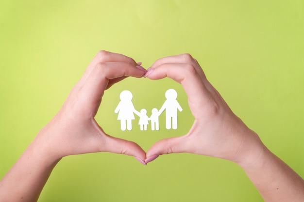 Symbol of a friendly family protecting health, a family of white paper. Premium Photo