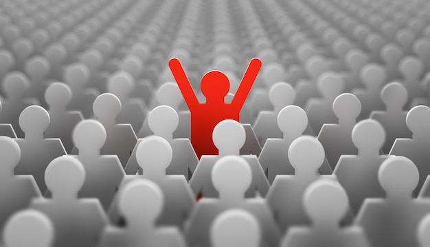 The symbol of a leader in the form of a red man with his hands up in a crowd of white men Premium Photo
