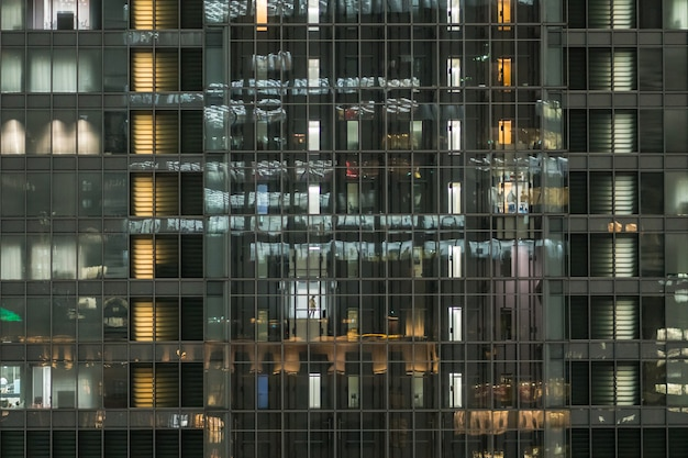 The symmetry of building offfce which have employee in lift on working hour Premium Photo