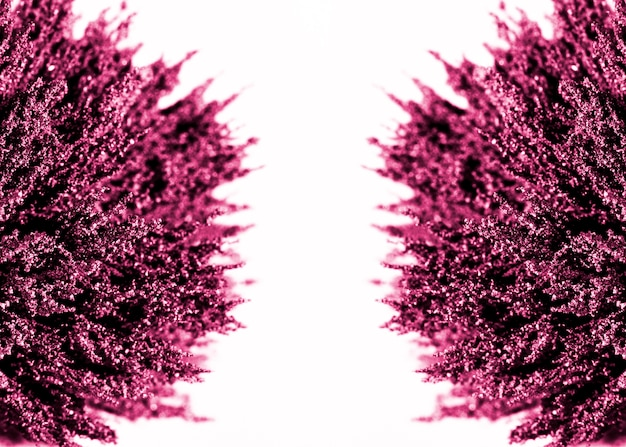 Symmetry of purple magnetic metallic shaving on white background Free Photo