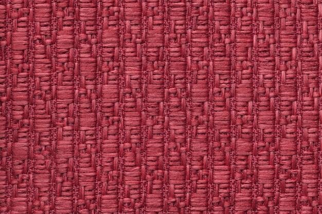 柔らかく、フリースの布のパターンで赤いニットウールの背景。 t Premium写真