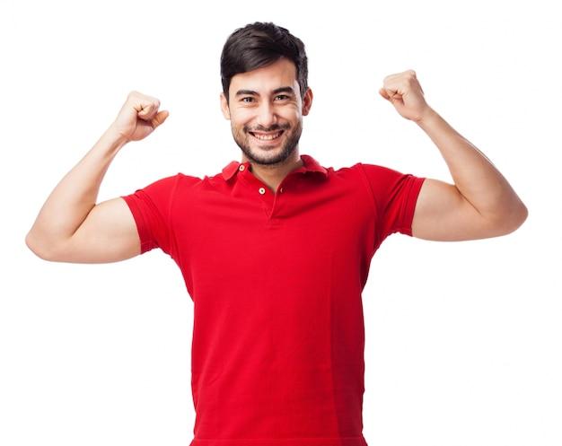 赤いtシャツとの強力なティーン 無料写真