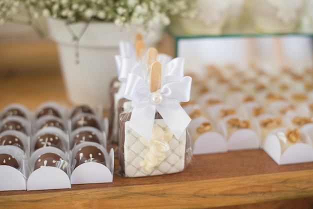 Table decorated with candy - baptism Premium Photo