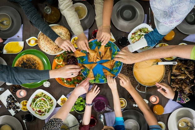 Table of enjoying food with family and friends top view Premium Photo