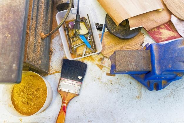 Table equipment mechanic paint brush saw blade sawdust