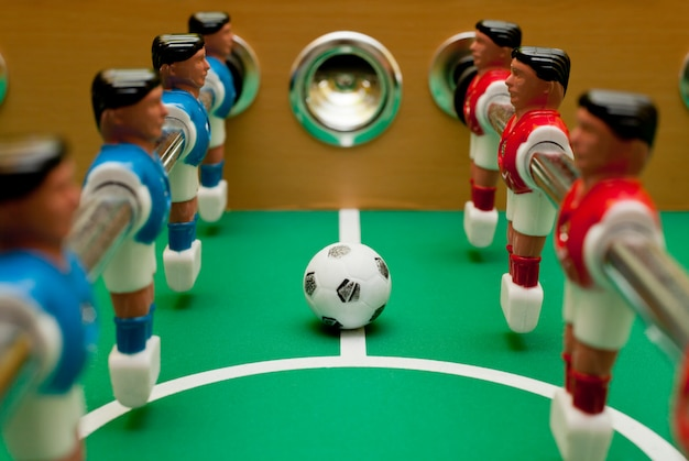Table football players, close-up with the ball. Premium Photo