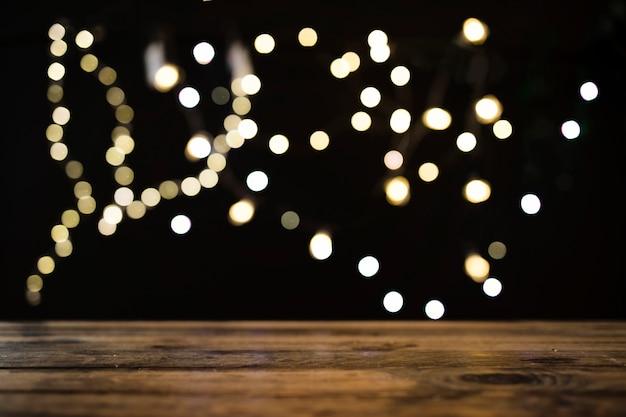 Table near blurred lights Free Photo