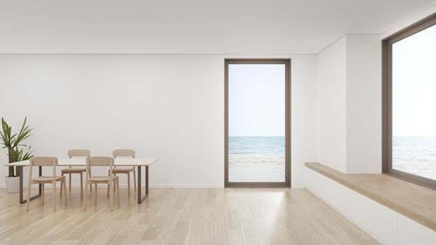 Стол на деревянном полу большой столовой в современном доме или роскошной гостинице. Premium Фотографии