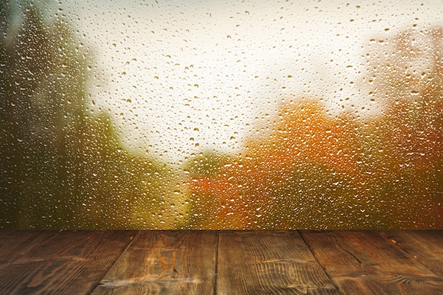 Table on rainy window background Premium Photo