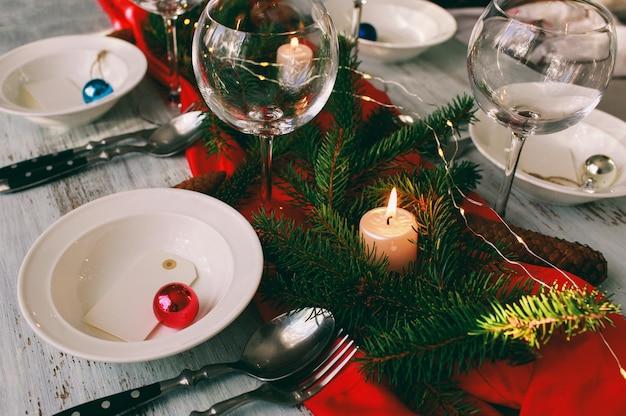 Table served for christmas dinner in living room. Premium Photo