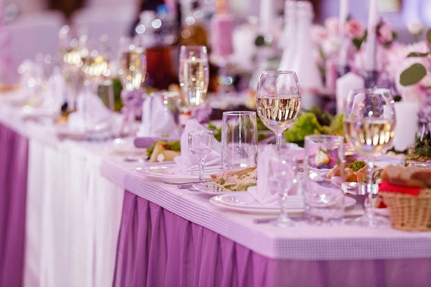 Table set for an event party or wedding reception. wedding table setting. wine glasses Premium Photo