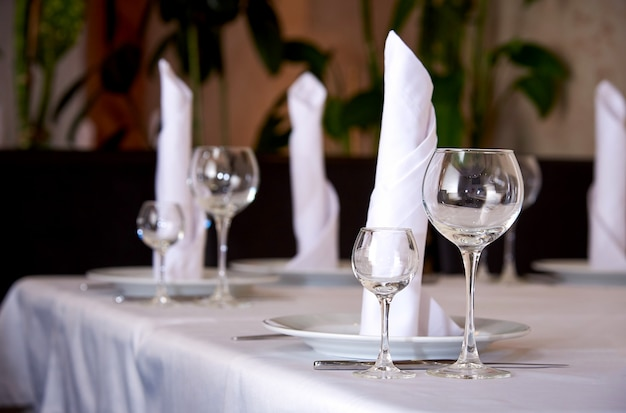 Table setting for a banquet or dinner party. Premium Photo
