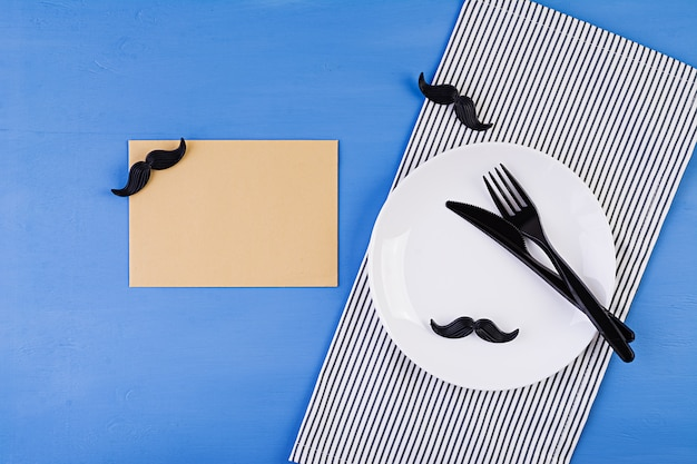 Table setting on fathers day with cutlery and mustache . happy fathers day Premium Photo