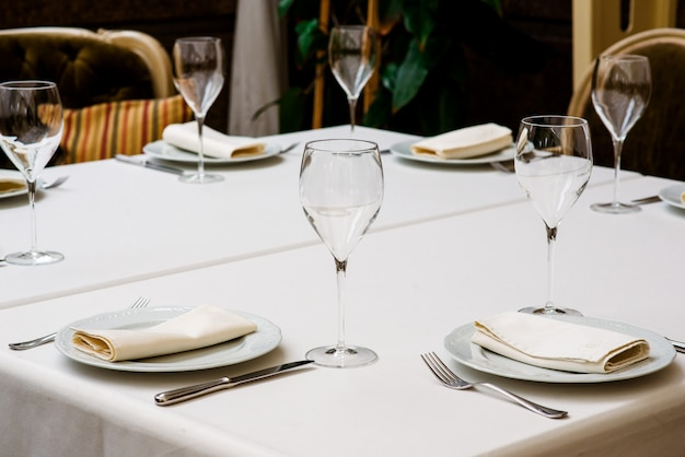 Table setting with an empty glass for wine. Premium Photo