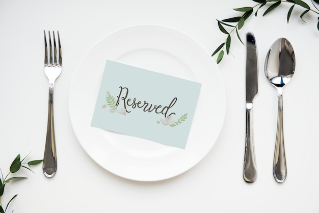 Table setting with reserved card Premium Photo
