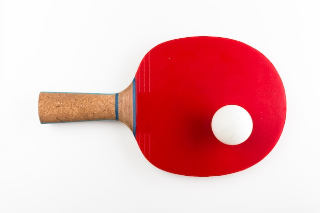 Table tennis racket and ball on a white background Premium Photo