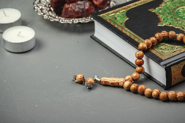 Table top decoration ramadan kareem holiday of dates with rosary and the holy book of koran Premium Photo